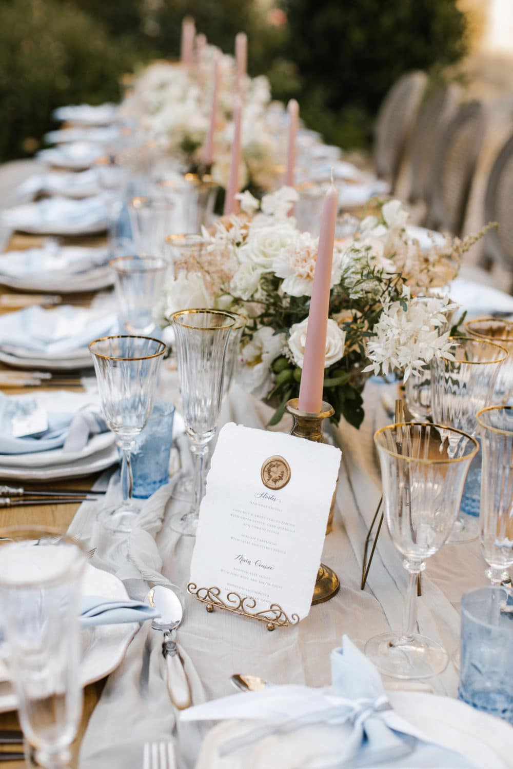 blush and soft blue tones for a romantic outside wedding dinner