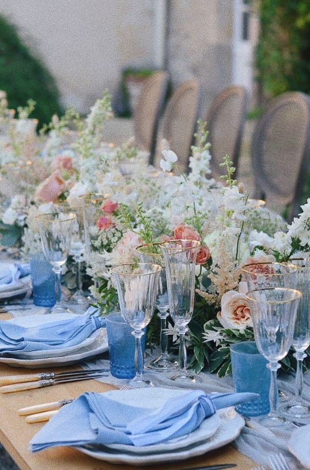 wedding table, soft blue napkins and vintage glasses