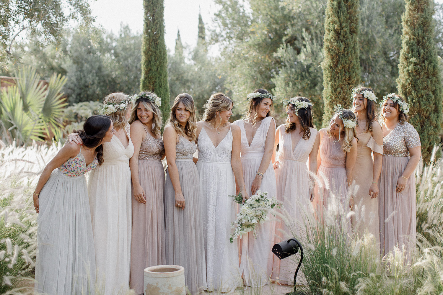 Bride and her bridesmaids in nude shades dresses
