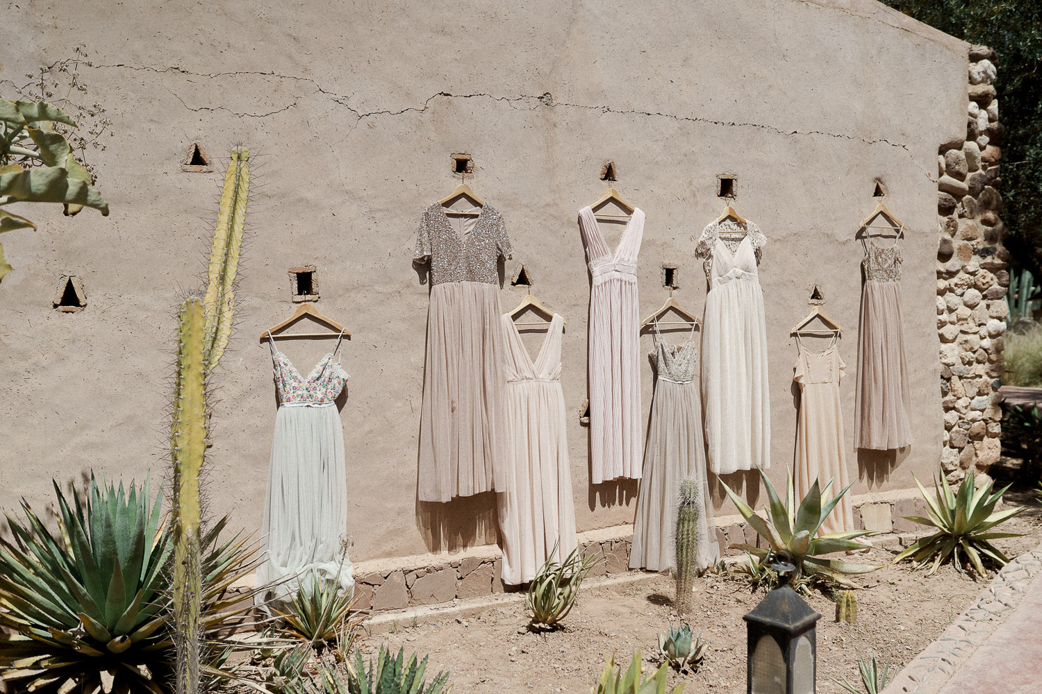 Bridesmaids dresses on moroccan wall