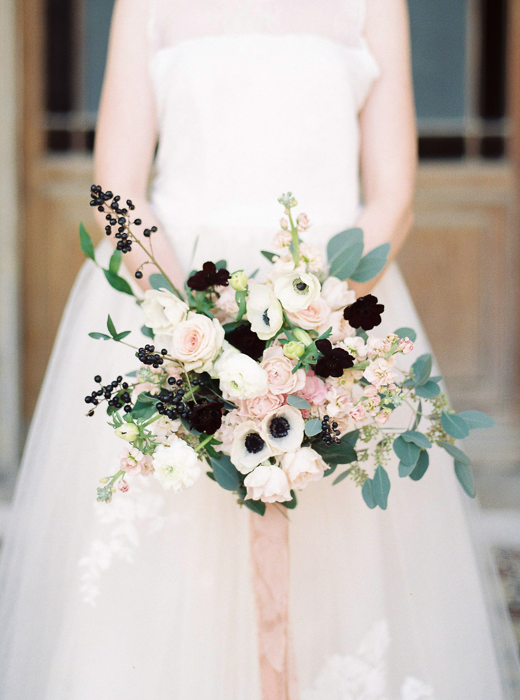 romantic bridal bouquet in white blush and black tones