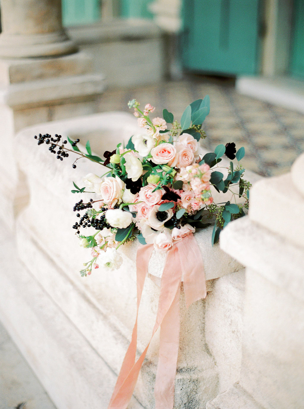 bridal bouquet with garden roses and anemones