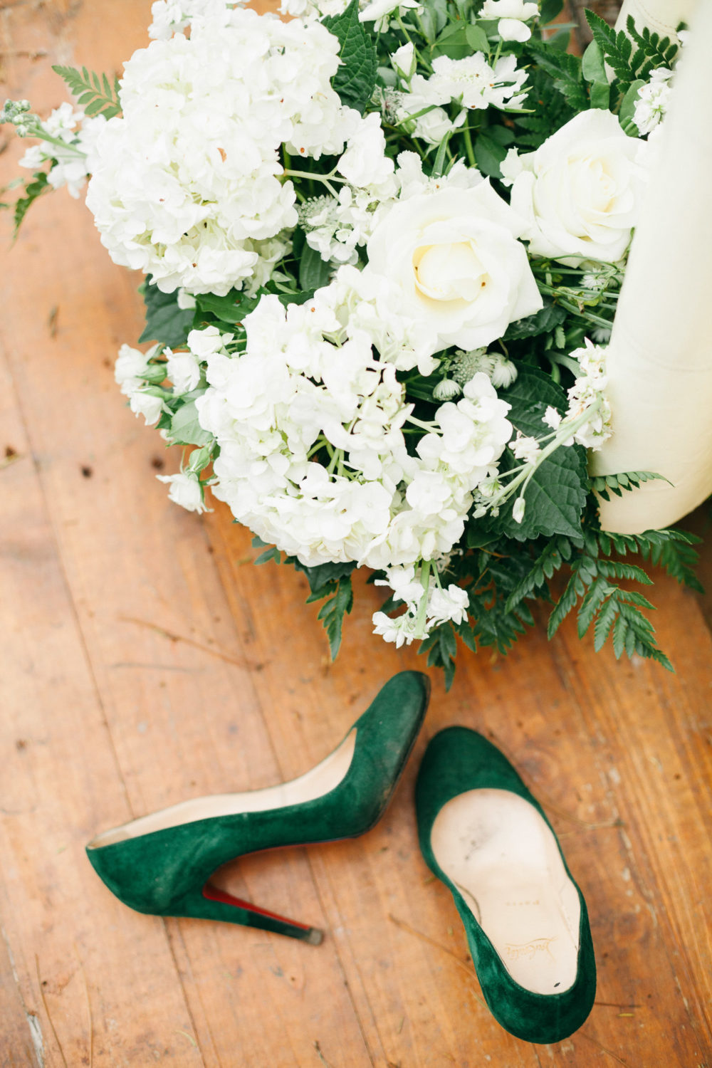 louboutin green heels with white wedding flowers