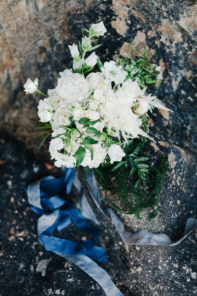 white bridal bouquet with blue hand tied silk ribbons