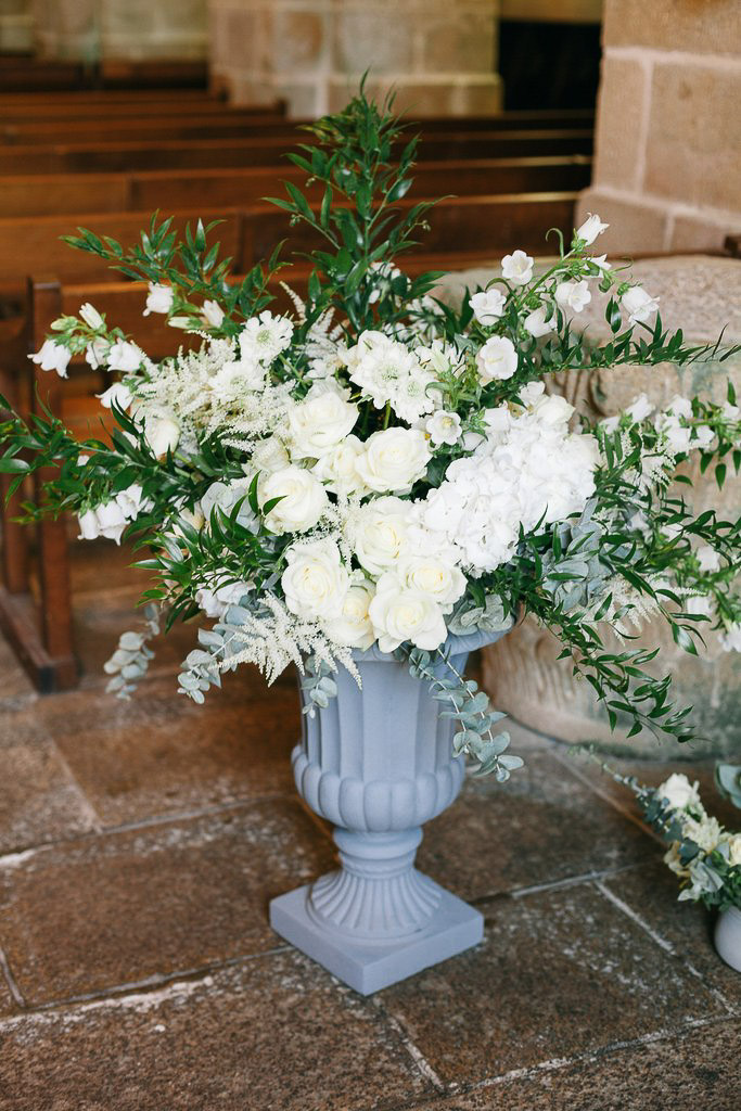 white elegant floral arrangement in medicis urn