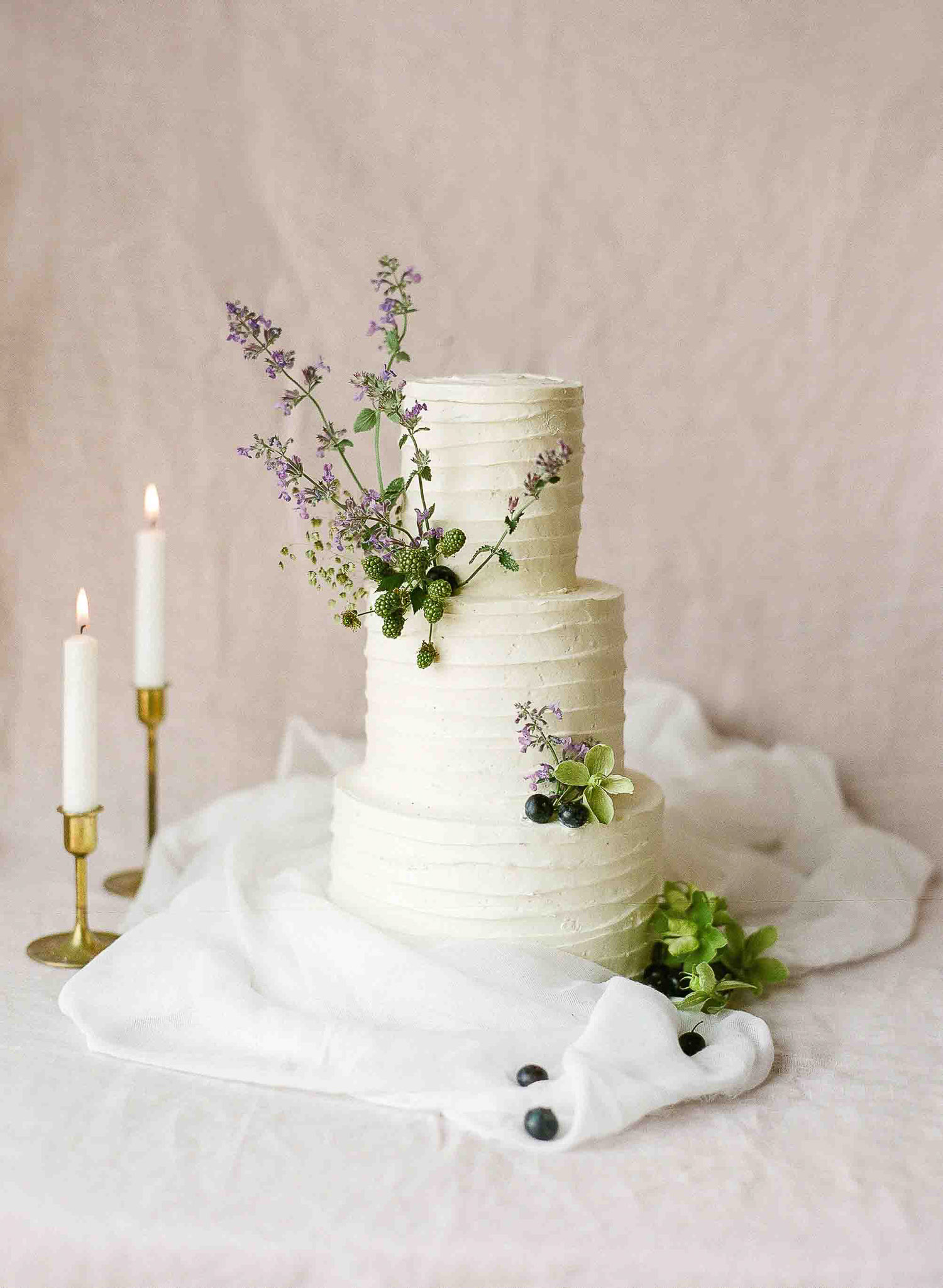white wedding cake with minimalist floral decor