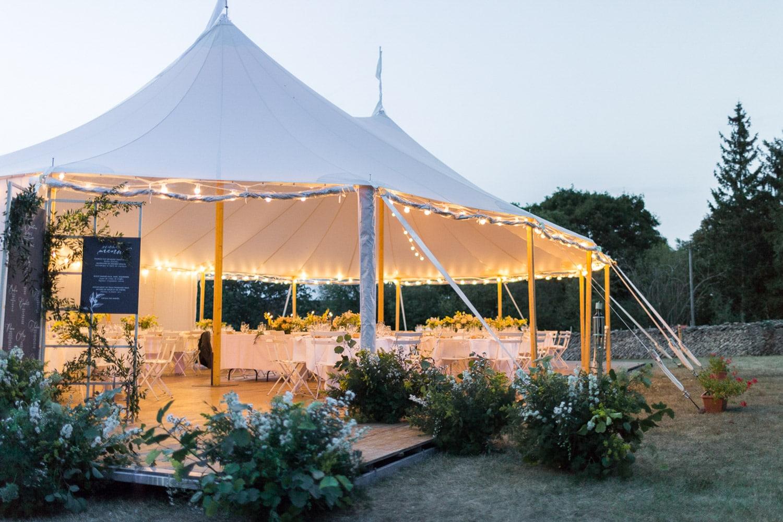 wedding dinner, outside wedding dinner, floral entrance, floral designer, wedding designer, wedding tent, wedding reception, natural wedding, organic wedding, greenery, floral decor