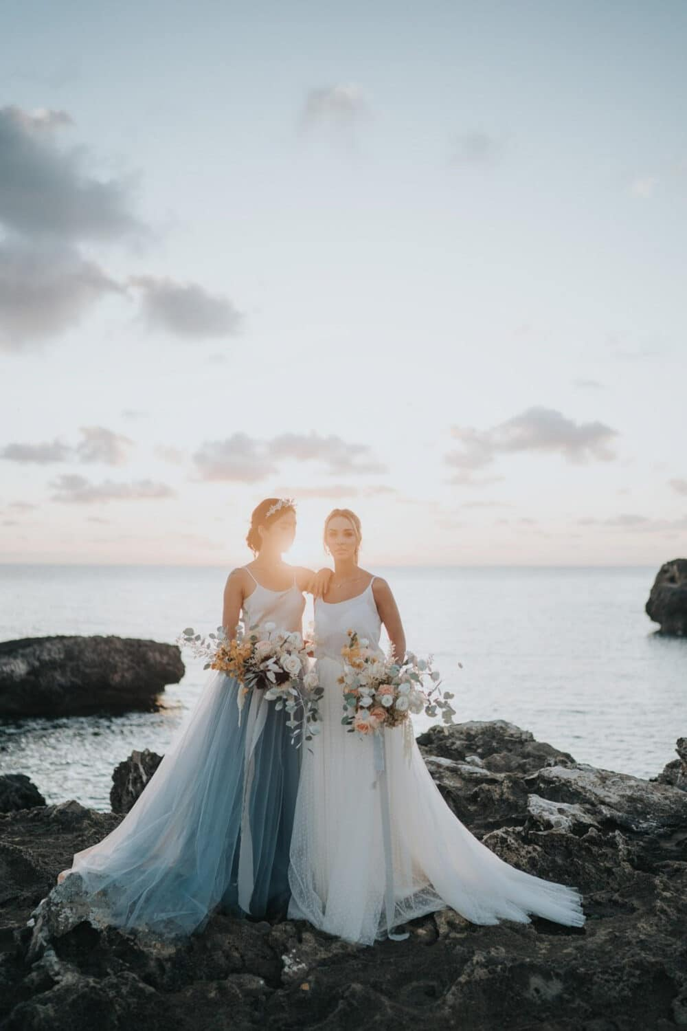 Two brides at sunset on the Mallorca coast